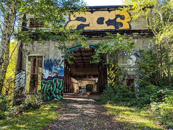 an abandoned power plant on Vancouver Island covered in graffiti.
