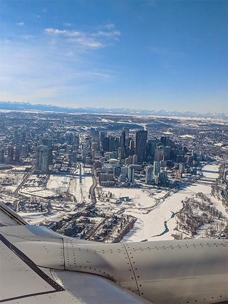 a look at Calgary from above while circling over the city in a plane.