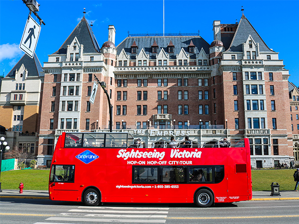 a picture of the Empress hotel in downtown Victoria, BC with a 'Sightseeing Victoria' bus passing in front