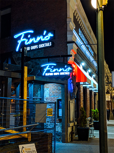 a shot of Finn's restaurant in downtown Victoria at night.