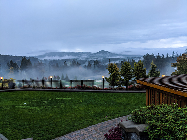 some mountains covered in fog on Vancouver Island