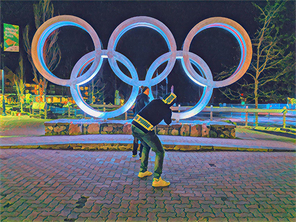 an altered photo of another photo being taken in front of the Olympic rings in Whistler