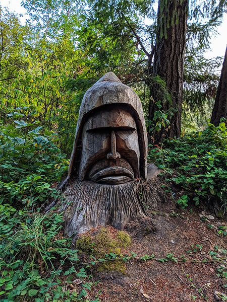 a large tree stump carved into the shape of a person's face